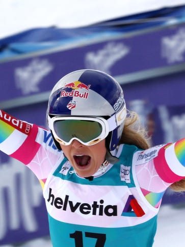 Lindsey Vonn celebrates in the finish area after winning