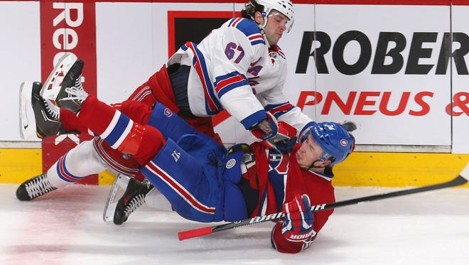 Left wing Benoit Pouliot (67) was part of a productive third line that helped the Rangers lead the conference in road wins.
