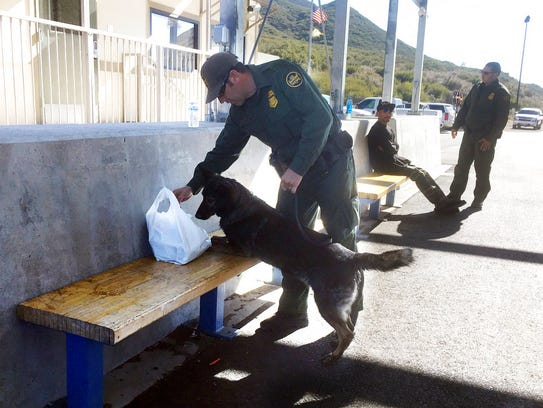 In this Thursday, Dec. 14, 2017 photo, a drug sniffing