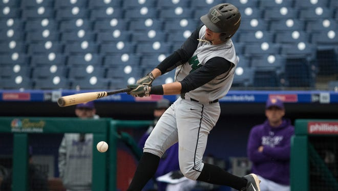 Wilmington's Max Carney (5) swings at a pitch during the Bill Giles Invitational against West Chester at Citizens Bank Park. Wilmington defeated West Chester 6-1.