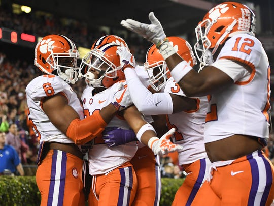 Clemson defensive back Ryan Carter (31) celebrates with teammates after returning an interception for a touchdown against South Carolina during the 1st quarter on Saturday, November 25, 2017 at Carolina's Williams Brice Stadium.