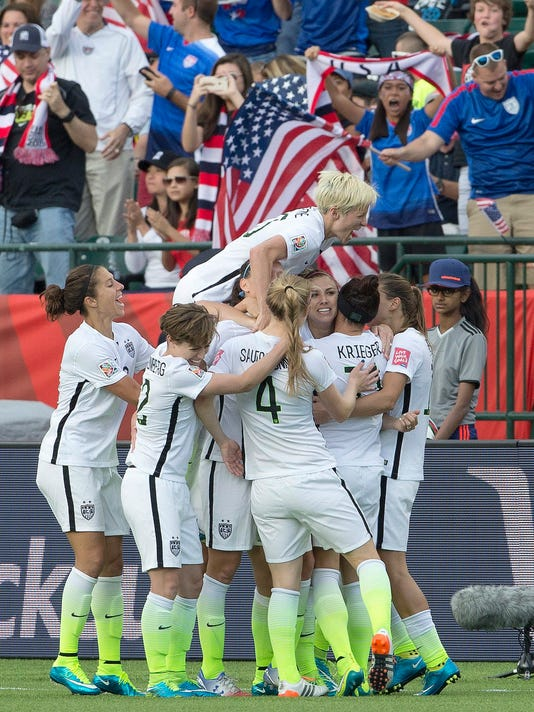 The United States team celebrates a goal against Colombia during second half FIFA Women's World Cup round of 16 soccer action in Edmonton, Alberta, Canada, Monday, June 22, 2015.
