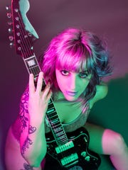 Angela Page is one of the people telling their tattoo tales Thursday, March 15, for the Southwest Florida Storytellers Project. Then her rock band, The Young Dead, releases its new EP on March 17 at HOWL in Fort Myers.