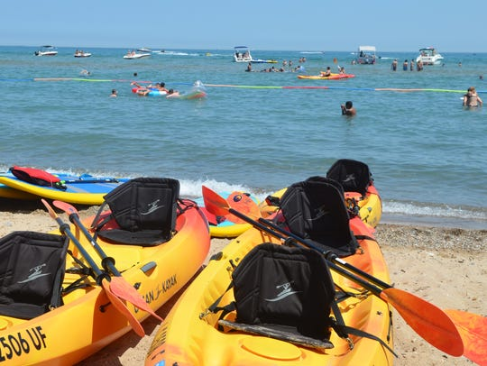 Kayaks wait to be rented at Lakeside Beach on July