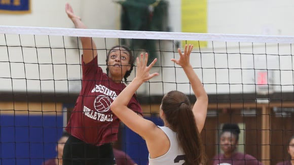 Ossining's Mychael Vernon returns the ball to Ursuline during a multi-team volleyball scrimmage at Mahopac High School Aug. 28, 2017.