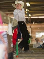 Hunter Rimes waits for his turn in the livestock auction on Saturday, March 7, 2015, at the Southwest Florida & Lee County Fair.