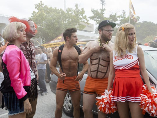 """This image released by Universal Pictures shows, from left, Carla Gallo, Ike Barinholtz, Zac Efron, Seth Rogen and Rose Byrne in a scene from """"Neighbors 2: Sorority Rising""""."""