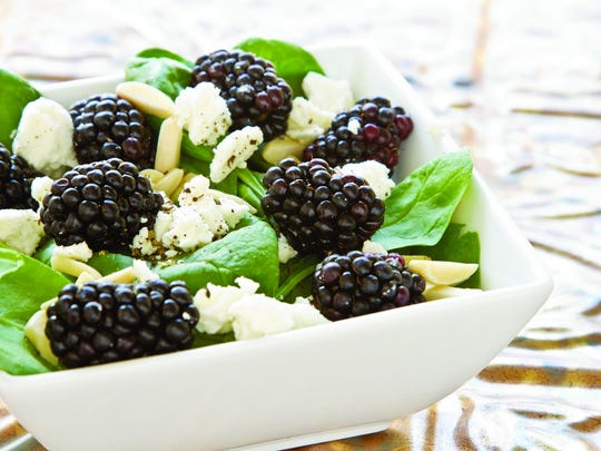 Freshly picked berries can be added to a spinach salad with nuts and feta for a nutritious meal.