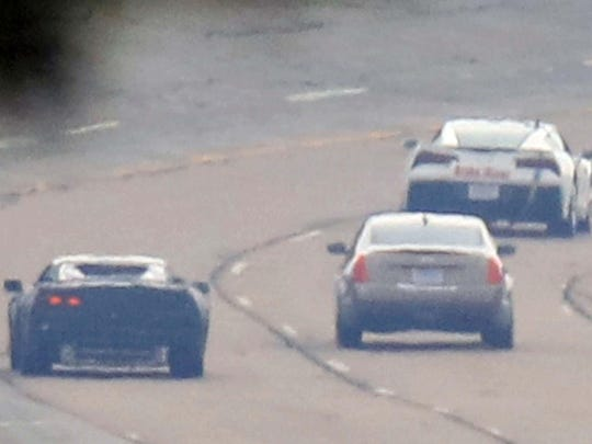 "In this spy shot taken in June, 2016 at GM's Milford Proving Grounds, the mid-engined Corvette C8 test ""mule"" (left) runs with a Cadilllac sedan (middle) and current Corvette C7."