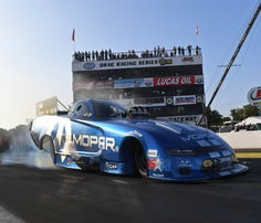 In this photo provided by the NHRA, Matt Hagan drives in Funny Car qualifying Friday, Aug. 16, 2019, at the Lucas Oil NHRA Nationals drag races at Brainerd International Raceway in Brainerd, Minn.  Hagan's best run was a 3.890-second pass at 328.46 mph. (Marc Gewertz/NHRA via AP)
