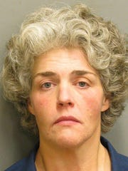 Lee Ann England is charged with unlawfully using slugs
