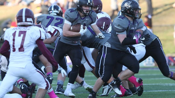 John Jay defeated Harrison 31-12 in playoff football action at John Jay High School in Cross River Oct. 15, 2016.