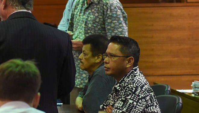 In this file photo, Department of Corrections officers charged with scheming to smuggle contraband into the prison are represented by their attorneys during a court hearing at the Superior Court of Guam in Hagåtña on Oct. 9, 2017.