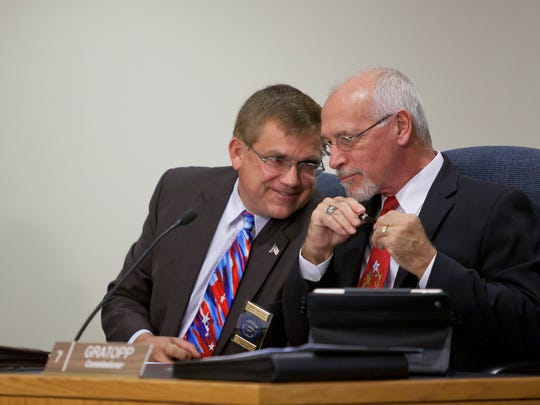 Commissioners David Rushing and Bill Gratopp speak during a meeting in 2014 at the St. Clair County Administrative Office Building in Port Huron.