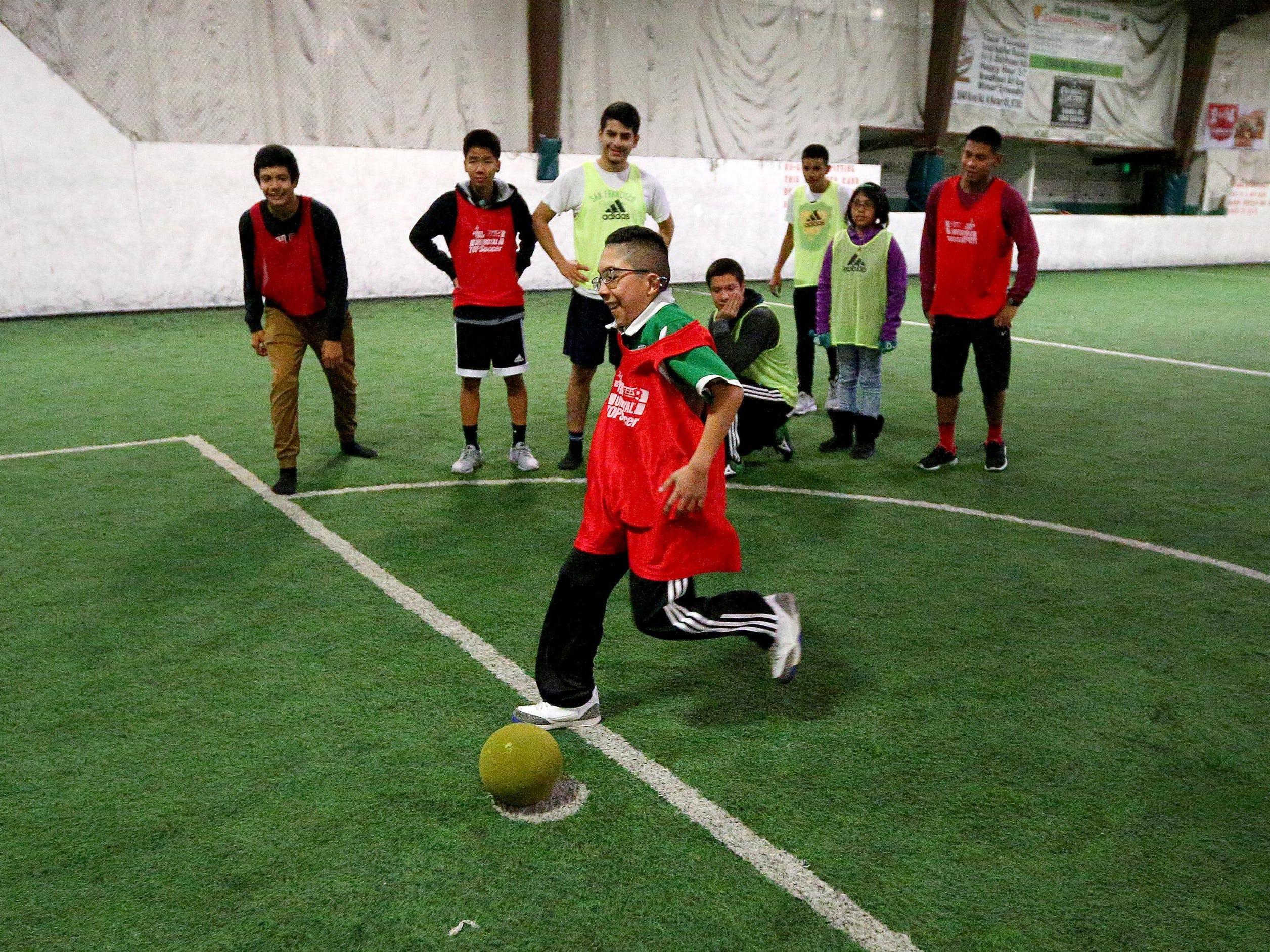 Corazon Barocio scores a goal on a penalty kick during a soccer program with North Salem High School's boys soccer.