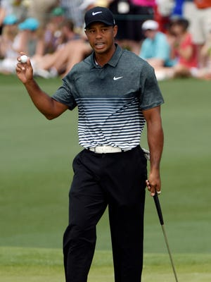Tiger Woods holds up his ball on the second hole during the third round of the Masters.
