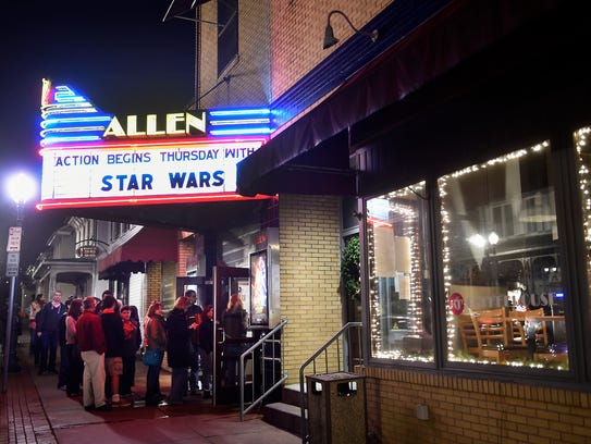 A line forms outside the neon-lit Allen Theatre in 2015 as moviegoers wait to see Star Wars: The Force Awakens.