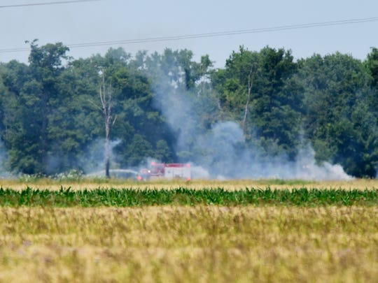 Smoke rises from a field that caught fire between Oak Harbor and Rocky Ridge on Tuesday.