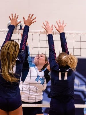 Frankfort's Anna Shaffer meets her opponents at the net as the Falcons took on the Cardinals. Tribune photo by Lee Brown/knobley.com
