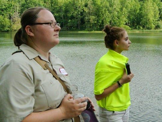 Ithaca Gorge Ranger Angela Sims, right, uses her body