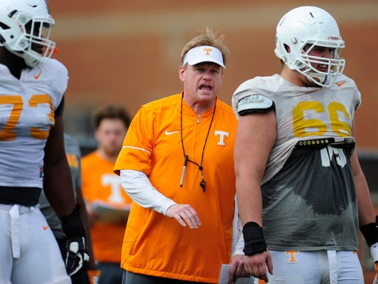 Vols offensive line coach Walt Wells instructs players