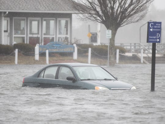 SCITUATE, MA - MARCH 02:  A flooded car parked in a