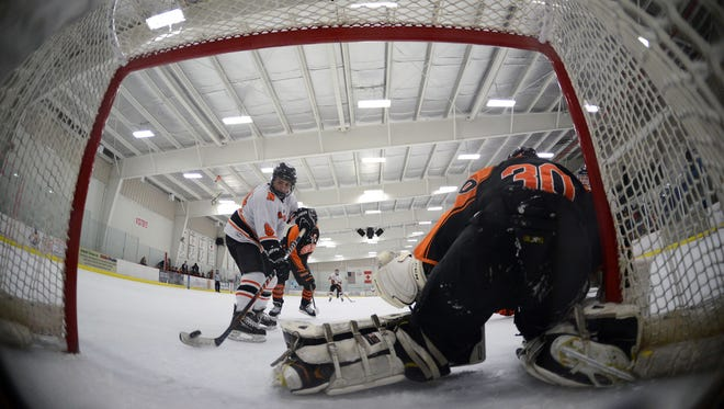 Northville's Anthony Solak scores the first goal in the opening period on Brighton goalie Jake Price.