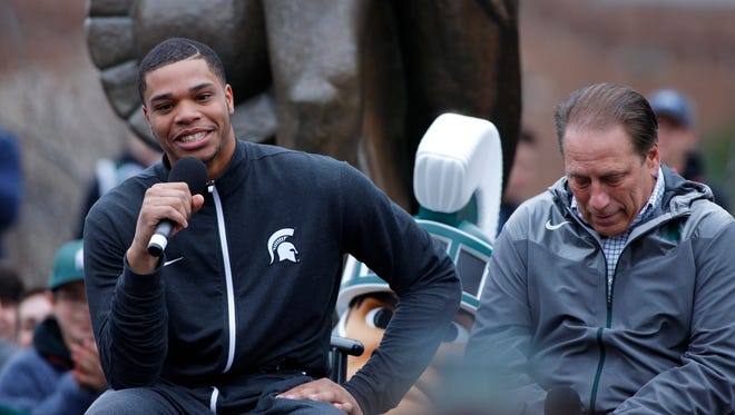 Michigan State forward Miles Bridges speaks as coach Tom Izzo listens during Bridges' announcement he is returning to school for his sophomore season April 13, 2017 in East Lansing.