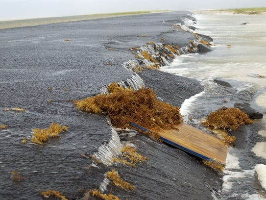 Storm surge caused by Tropical Storm Cindy breaches