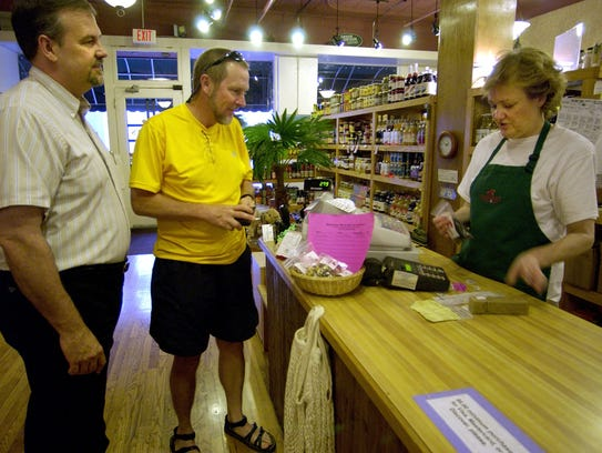 David Ladd, left, and Mike Deaton make a purchase from