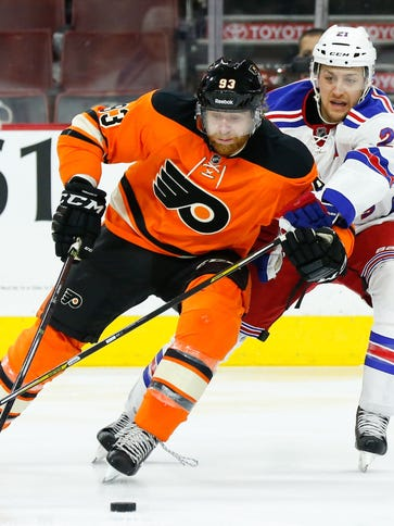 Flyers right wing Jakub Voracek skates with the puck