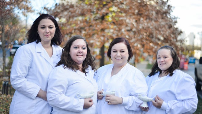 Members of the Wisconsin Nurses Honor Guard seek to recognize the work of nurses at the time of their deaths. From left, Jamie Bohacek, President and founder of the group, April Johnson, funeral coordinator,  Brittany Wohlfeil, vice president and co-founder and group member Cacee-Kaeden Cole.