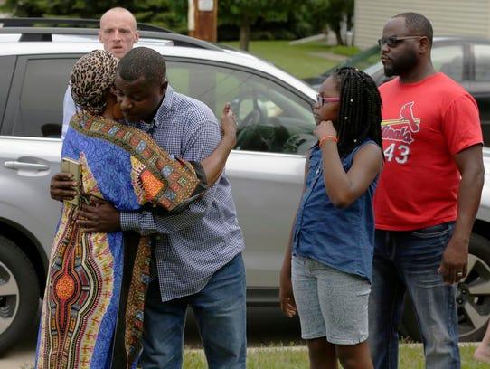 Rosie Harvey, grandmother of Isaiah Tucker, hugs Jeremy