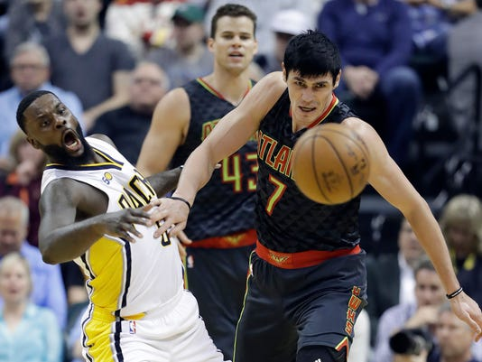 Indiana Pacers' Lance Stephenson and Atlanta Hawks' Ersan Ilyasova eye a loose ball during the first half of an NBA basketball game Wednesday, April 12, 2017, in Indianapolis. (AP Photo/Darron Cummings)