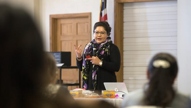 Denisa Livingston of the Dine Community Advocacy Alliance gives a presentation Friday during a program on healthy food initiatives at the Nenahnezad Chapter house.