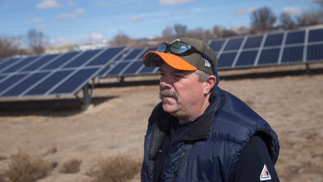 Ken George, Aztec's electric director talks during an interview on Monday, March 12, 2018 at the Aztec solar farm.
