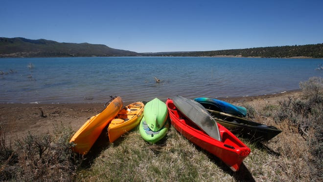 Kayaks sit on the shore Monday at Lake Nighthorse in Durango, Colorado.