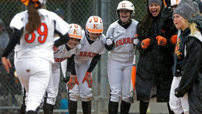 Kaukauna's Haley Hestekin (left) is greeted at the plate by her teammates after hitting a three-run home run against Appleton North on Tuesday in Kaukauna.