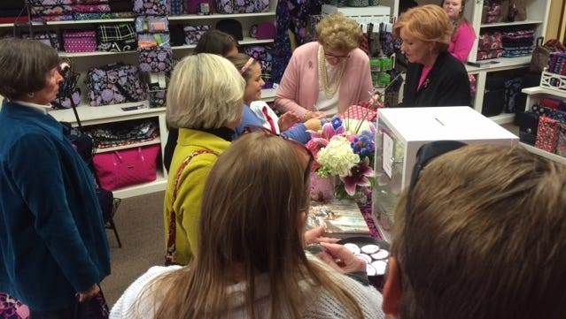 Joan Bradley Reedy (pink sweater) and Barbara Bradley Baekgaard (red hair) of Vera Bradley talk with customers at Wilkins & Olander in Sturgeon Bay on Saturday in a fundraiser for breast cancer research. A portion of sales went to the Vera Bradley Foundation.