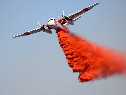 A Cal Fire air tanker makes a drop on the Boca Fire Monday afternoon.