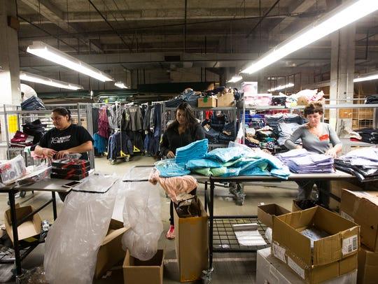 JC Penney support associates prepare merchandise for
