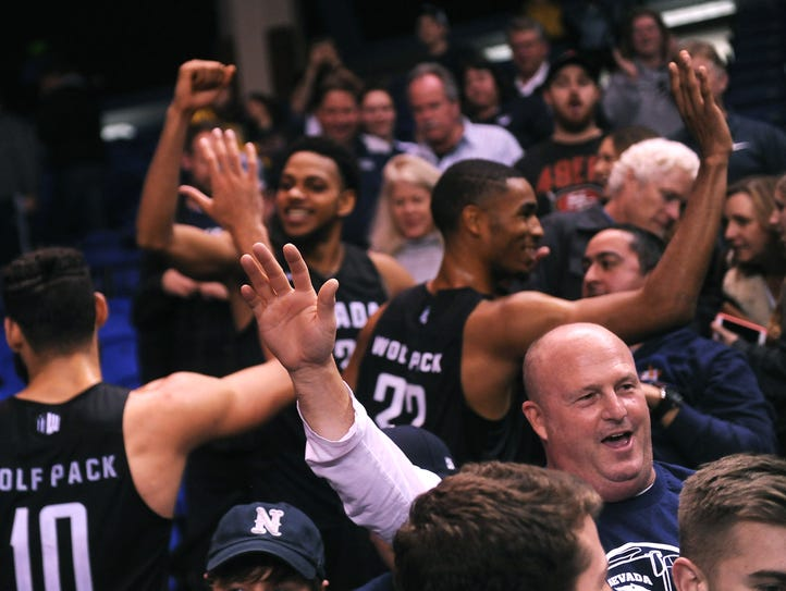 Nevada players and fans celebrate their victory over