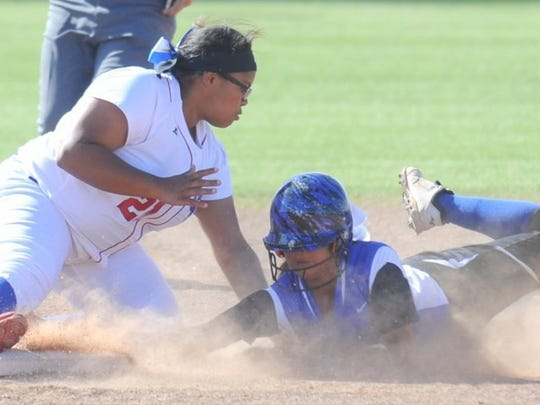 Joey D. Richards/Reporter-News Cooper shortstop Adora Garcia, left, tags out San Angelo Lake View's Ragen Noriega, who was trying to steal second in the fourth inning. Cooper beat the Maidens 2-1 in the District 4-5A opener Tuesday at Cougar Diamond.