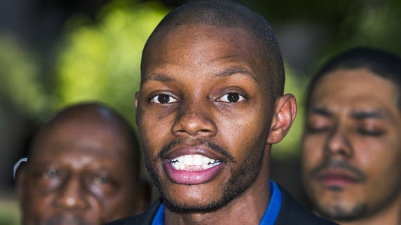 Rep. Reginald Bolding, D-Laveen, calls for the removal of the Jefferson Davis Memorial Highway during a news conference in Phoenix on Wednesday, June 24, 2015. Bolding said it is time for references to the pro-slavery movement that are hurtful to African-Americans be removed from buildings, highways and any other public spaces that honor the Confederacy.