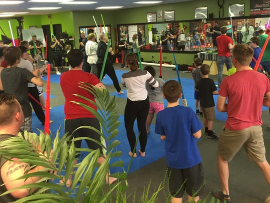 About 80 people turned up for a recent lightsaber training