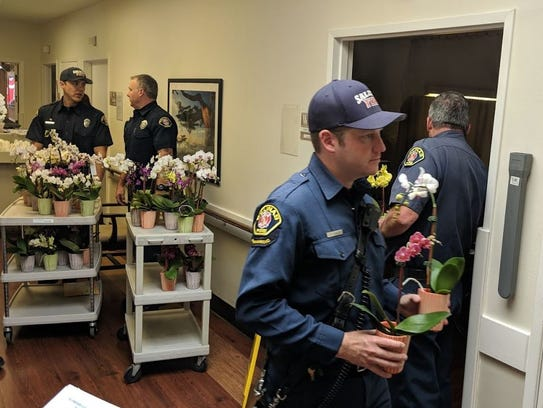 Salinas firefighters deliver flowers for seniors on