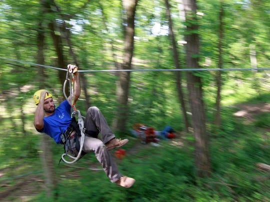 Nick Dickerson, who works for Screaming Eagles Adventures, helped build a zip line at the Creation Museum in 2013. The Creation Museum's request for a zone change of 55 acres was approved by Boone County Fiscal Court on April 5. The museum will add a new three-story building and a parking lot.