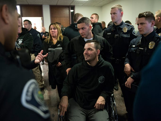 Camden Police Officer Patrick O'Hanlon is surrounded