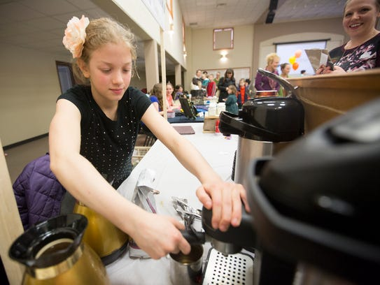 Emily Lewerenz, 10, of Weston makes a latte at her