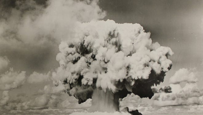 An atomic cloud forms from the underwater Baker Day Explosion over Bikini Lagoon, July 25, 1946. The United States relocated inhabitants of Bikini Atoll before exploding 23 nuclear weapons in Bikini between 1946 and 1958.